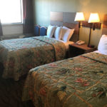 standard two double beds room at Beachcomber Inn