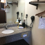 guestroom vanity and hanger space at Beachcomber Inn